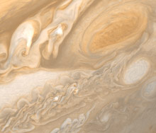 The Great Red Spot (upper right) is wide enough to swallow two Earths.